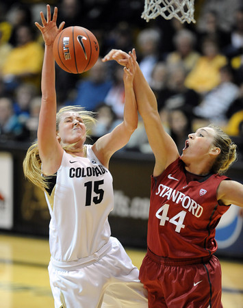 "Julia Seabrook of CU, gets her shot blocked by Joslyn Tinkle of Stanford on Saturday.<br /> For more photos of the game, go to  <a href=""http://www.dailycamera.com"">http://www.dailycamera.com</a>.<br /> January 14, 2012 / Cliff Grassmick"