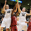 "Rachel Hargis, left, and Meagan Malcom-Peck (14) of CU, battle with Chiney Ogwumike of Stanford.<br /> For more photos of the game, go to  <a href=""http://www.dailycamera.com"">http://www.dailycamera.com</a>.<br /> January 14, 2012 / Cliff Grassmick"