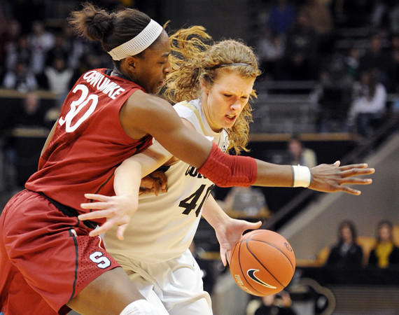"""Nnemkadi Ogwumike of Stanford  tries to contain Rachel Hargis of CU.<br /> For more photos of the game, go to  <a href=""""http://www.dailycamera.com"""">http://www.dailycamera.com</a>.<br /> January 14, 2012 / Cliff Grassmick"""