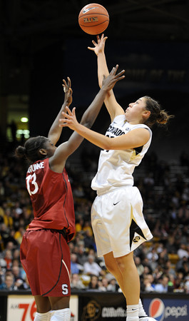 """Jasmine Sborov of CU shoots over Chiney Ogwumike of Stanford.<br /> For more photos of the game, go to  <a href=""""http://www.dailycamera.com"""">http://www.dailycamera.com</a>.<br /> January 14, 2012 / Cliff Grassmick"""