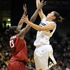 "Jasmine Sborov of CU shoots over Chiney Ogwumike of Stanford.<br /> For more photos of the game, go to  <a href=""http://www.dailycamera.com"">http://www.dailycamera.com</a>.<br /> January 14, 2012 / Cliff Grassmick"
