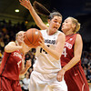 """Meagan Malcolm-Peck of CU gets a rebound n front of Joslyn Tinkle of Stanford.<br /> For more photos of the game, go to  <a href=""""http://www.dailycamera.com"""">http://www.dailycamera.com</a>.<br /> January 14, 2012 / Cliff Grassmick"""