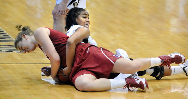 """Toni Kokenis of Stanford gets tied up with  Ashley Wilson of CU.<br /> For more photos of the game, go to  <a href=""""http://www.dailycamera.com"""">http://www.dailycamera.com</a>.<br /> January 14, 2012 / Cliff Grassmick"""
