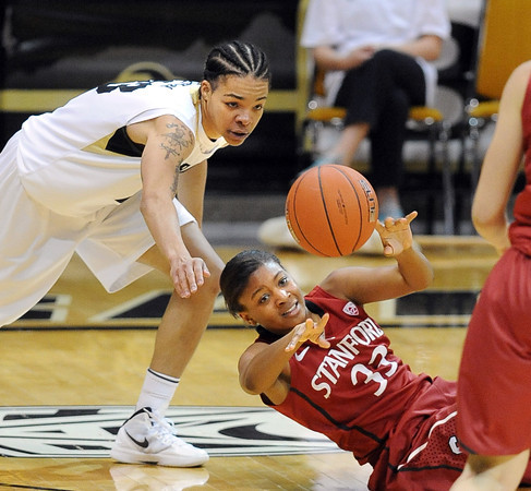 "Amber Orrange of Stanford gets the ball away from Chucky Jeffery of CU.<br /> For more photos of the game, go to  <a href=""http://www.dailycamera.com"">http://www.dailycamera.com</a>.<br /> January 14, 2012 / Cliff Grassmick"