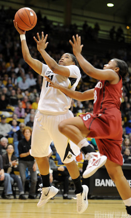 """Ashley Wilson of CU drives past Amber Orrange of Stanford.<br /> For more photos of the game, go to  <a href=""""http://www.dailycamera.com"""">http://www.dailycamera.com</a>.<br /> January 14, 2012 / Cliff Grassmick"""