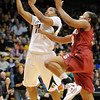 "Ashley Wilson of CU drives past Amber Orrange of Stanford.<br /> For more photos of the game, go to  <a href=""http://www.dailycamera.com"">http://www.dailycamera.com</a>.<br /> January 14, 2012 / Cliff Grassmick"