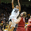 "Chucky Jeffery of CU scores past Lindy La Rocque of Stanford.<br /> For more photos of the game, go to  <a href=""http://www.dailycamera.com"">http://www.dailycamera.com</a>.<br /> January 14, 2012 / Cliff Grassmick"