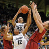 "Chucky Jeffery (23) and Ashley Wilson, both of CU, try to rebound the ball from Joslyn Tinkle, right, of Stanford.<br /> For more photos of the game, go to  <a href=""http://www.dailycamera.com"">http://www.dailycamera.com</a>.<br /> January 14, 2012 / Cliff Grassmick"