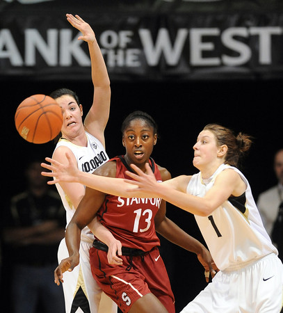 "Lexy Kresl (1) of CU, tries to control the ball as Meagan Malcolm-Peck of CU, and Chiney Ogwumike of Stanford, look on.<br /> For more photos of the game, go to  <a href=""http://www.dailycamera.com"">http://www.dailycamera.com</a>.<br /> January 14, 2012 / Cliff Grassmick"