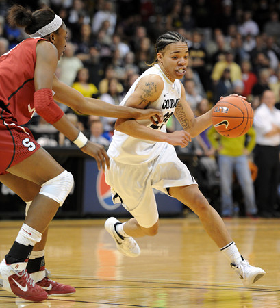 "Chucky Jeffery of CU drives past Nnemkadi Ogwumike of Stanford.<br /> For more photos of the game, go to  <a href=""http://www.dailycamera.com"">http://www.dailycamera.com</a>.<br /> January 14, 2012 / Cliff Grassmick"