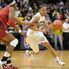 """Chucky Jeffery of CU drives past Nnemkadi Ogwumike of Stanford.<br /> For more photos of the game, go to  <a href=""""http://www.dailycamera.com"""">http://www.dailycamera.com</a>.<br /> January 14, 2012 / Cliff Grassmick"""
