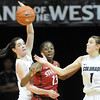 """Lexy Kresl (1) of CU, tries to control the ball as Meagan Malcolm-Peck of CU, and Chiney Ogwumike of Stanford, look on.<br /> For more photos of the game, go to  <a href=""""http://www.dailycamera.com"""">http://www.dailycamera.com</a>.<br /> January 14, 2012 / Cliff Grassmick"""