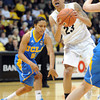 "Chucky Jeffery of CU gets past Mariah Williams of UCLA<br /> during the first half of the January 29, 2012 game in Boulder. <br /> For more photos of the game, go to  <a href=""http://www.dailycamera.com"">http://www.dailycamera.com</a>.<br /> January 29, 2012 / Cliff Grassmick"