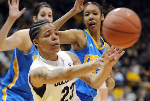 "Chucky Jeffery of Colorado gets the ball away from the UCLA defenders during the first half of the January 29, 2012 game in Boulder. <br /> For more photos of the game, go to  <a href=""http://www.dailycamera.com"">http://www.dailycamera.com</a>.<br /> January 29, 2012 / Cliff Grassmick"