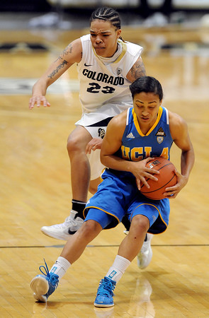 "Chucky Jeffery of CU flies over Mariah Williams of UCLA<br /> during the second half of the January 29, 2012 game in Boulder. <br /> For more photos of the game, go to  <a href=""http://www.dailycamera.com"">http://www.dailycamera.com</a>.<br /> January 29, 2012 / Cliff Grassmick"