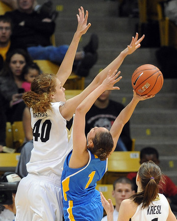 "Rachel Hargis of CU blocks the shot of Thea Lemberger of UCLA<br /> during the second half of the January 29, 2012 game in Boulder. <br /> For more photos of the game, go to  <a href=""http://www.dailycamera.com"">http://www.dailycamera.com</a>.<br /> January 29, 2012 / Cliff Grassmick"