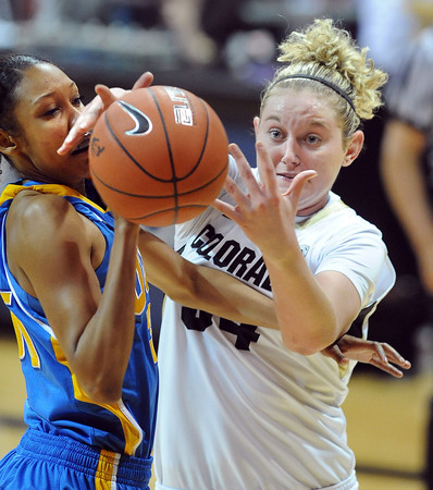 "Rebekah Gardner, left of UCLA, and Jen Reese of Colorado struggle for a rebound during the second half of the January 29, 2012 game in Boulder. <br /> For more photos of the game, go to  <a href=""http://www.dailycamera.com"">http://www.dailycamera.com</a>.<br /> January 29, 2012 / Cliff Grassmick"