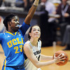 "Meagan Malcolm-Peck of CU tries to shoot over Markel Walker of UCLA during the second half of the January 29, 2012 game in Boulder. <br /> For more photos of the game, go to  <a href=""http://www.dailycamera.com"">http://www.dailycamera.com</a>.<br /> January 29, 2012 / Cliff Grassmick"