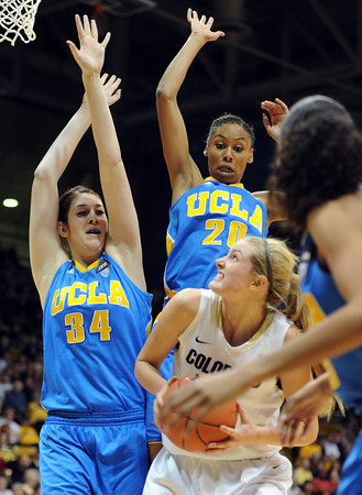 """Julie Seabrook of CU goes up on Corinne Costa (34) and Rhema Gardner, both of UCLA, during the first half of the January 29, 2012 game in Boulder. <br /> For more photos of the game, go to  <a href=""""http://www.dailycamera.com"""">http://www.dailycamera.com</a>.<br /> January 29, 2012 / Cliff Grassmick"""