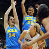 "Julie Seabrook of CU goes up on Corinne Costa (34) and Rhema Gardner, both of UCLA, during the first half of the January 29, 2012 game in Boulder. <br /> For more photos of the game, go to  <a href=""http://www.dailycamera.com"">http://www.dailycamera.com</a>.<br /> January 29, 2012 / Cliff Grassmick"