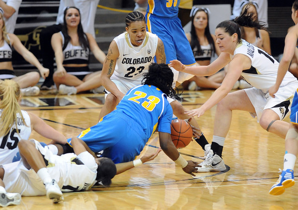"Markel Walker (23) of UCLA, tries to keep a loose ball from Chucky Jeffery and Meagan Malcom-Peck of CU during the second half of the January 29, 2012 game in Boulder. <br /> For more photos of the game, go to  <a href=""http://www.dailycamera.com"">http://www.dailycamera.com</a>.<br /> January 29, 2012 / Cliff Grassmick"