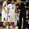 """Linda Lappe talks to Chucky Jeffery and Brittany Wilson<br /> during the first half of the January 29, 2012 game in Boulder. <br /> For more photos of the game, go to  <a href=""""http://www.dailycamera.com"""">http://www.dailycamera.com</a>.<br /> January 29, 2012 / Cliff Grassmick"""