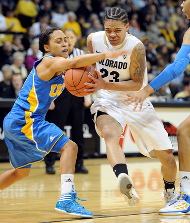Chucky Jeffery of Colorado, drives past Mariah Williams of UCLA during the first half of the January 29, 2012 game in Boulder. <br /> January 29, 2012 / Cliff Grassmick