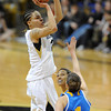 "Chucky Jeffery of CU shoots over Thea Lemberger of UCLA<br /> during the second half of the January 29, 2012 game in Boulder. <br /> For more photos of the game, go to  <a href=""http://www.dailycamera.com"">http://www.dailycamera.com</a>.<br /> January 29, 2012 / Cliff Grassmick"
