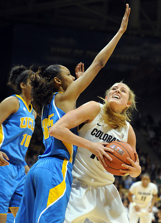 "Julie Seabrook of CU goes up on Rebekah Gardner of UCLA<br /> during the first half of the January 29, 2012 game in Boulder. <br /> For more photos of the game, go to  <a href=""http://www.dailycamera.com"">http://www.dailycamera.com</a>.<br /> January 29, 2012 / Cliff Grassmick"