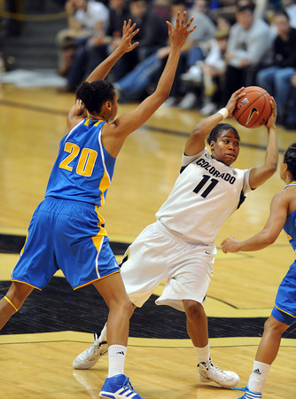 """Brittany Wilson of CU is stopped by Rhema Gardner of UCLA<br /> during the second half of the January 29, 2012 game in Boulder. <br /> For more photos of the game, go to  <a href=""""http://www.dailycamera.com"""">http://www.dailycamera.com</a>.<br /> January 29, 2012 / Cliff Grassmick"""