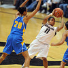 "Brittany Wilson of CU is stopped by Rhema Gardner of UCLA<br /> during the second half of the January 29, 2012 game in Boulder. <br /> For more photos of the game, go to  <a href=""http://www.dailycamera.com"">http://www.dailycamera.com</a>.<br /> January 29, 2012 / Cliff Grassmick"