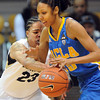 Chucky Jeffery, left,  of Colorado, tries to knock he ball from Rebekah Gardner of UCLA during the first half of the January 29, 2012 game in Boulder. <br /> January 29, 2012 / Cliff Grassmick