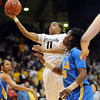 """Brittany Wilson of CU scores past Markel Walker of UCLA<br /> during the first half of the January 29, 2012 game in Boulder. <br /> For more photos of the game, go to  <a href=""""http://www.dailycamera.com"""">http://www.dailycamera.com</a>.<br /> January 29, 2012 / Cliff Grassmick"""