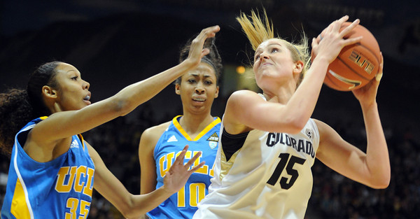 "Julie Seabook of CU goes up to shoot over Rebekah Gardner (35) and Kacy Swain of UCLA during the first half of the January 29, 2012 game in Boulder. <br /> For more photos of the game, go to  <a href=""http://www.dailycamera.com"">http://www.dailycamera.com</a>.<br /> January 29, 2012 / Cliff Grassmick"