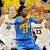 "Markel Walker (23) of UCLA catches a pass in from of Julie Seabrook, left, and Chucky Jeffery, both of Colorado, during the second half of the January 29, 2012 game in Boulder. <br /> For more photos of the game, go to  <a href=""http://www.dailycamera.com"">http://www.dailycamera.com</a>.<br /> January 29, 2012 / Cliff Grassmick"