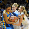 "Kacy Swain, left, of UCLA, gets tied up by Jen Reese and Julie Seabrook of Colorado during the first half of the January 29, 2012 game in Boulder. <br /> For more photos of the game, go to  <a href=""http://www.dailycamera.com"">http://www.dailycamera.com</a>.<br /> January 29, 2012 / Cliff Grassmick"