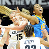Julie Seabrook (15) of Colorado, gets a rebound from Kacy Swain of UCLA  during the first half of the January 29, 2012 game in Boulder. <br /> January 29, 2012 / Cliff Grassmick