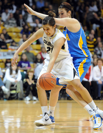 """Jasmine Sborov of CU gets hit from behind by Corinne Costa of UCLA<br /> during the first half of the January 29, 2012 game in Boulder. <br /> For more photos of the game, go to  <a href=""""http://www.dailycamera.com"""">http://www.dailycamera.com</a>.<br /> January 29, 2012 / Cliff Grassmick"""