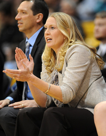 "Former Buff, Jenny (Roulier) Huth, is an assistant coach for UCLA.<br /> For more photos of the game, go to  <a href=""http://www.dailycamera.com"">http://www.dailycamera.com</a>.<br /> January 29, 2012 / Cliff Grassmick"