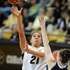 "Jasmine Sborov of CU shoots over Lauren Burford of Villanova<br /> during the second half of the March 22, 2012 game in Boulder. <br /> For more photos of the game, go to  <a href=""http://www.dailycamera.com"">http://www.dailycamera.com</a>.<br />  Cliff Grassmick / March 22, 2012"