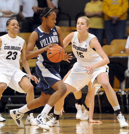 "Taylor Holeman of Villanova dribbles around Julie Seabrook of Colorado during the first half of the March 22, 2012 game in Boulder. <br /> For more photos of the game, go to  <a href=""http://www.dailycamera.com"">http://www.dailycamera.com</a>.<br />  Cliff Grassmick / March 22, 2012"