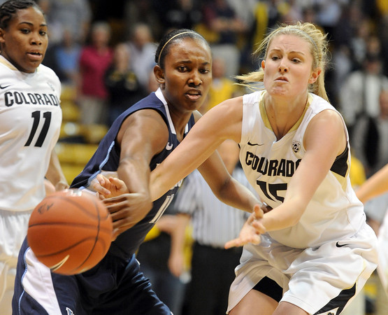 "Julie Seabrook, right, of CU, passes around Taylor Holeman of Villanova during the first half of the March 22, 2012 game in Boulder. <br /> For more photos of the game, go to  <a href=""http://www.dailycamera.com"">http://www.dailycamera.com</a>.<br />  Cliff Grassmick / March 22, 2012"