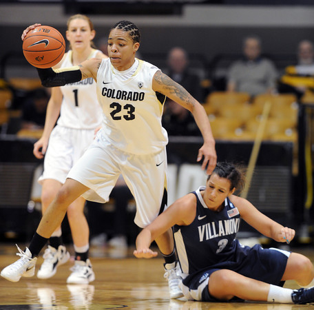 "Chucky Jeffery, left, of Colorado, gets a steal from Jesse Carey of Villanovaduring the first half of the March 22, 2012 game in Boulder. <br /> For more photos of the game, go to  <a href=""http://www.dailycamera.com"">http://www.dailycamera.com</a>.<br />  Cliff Grassmick / March 22, 2012"