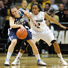 "Devon Kane of Villanova tries to move around Ashley Wilson of Colorado during the first half of the March 22, 2012 game in Boulder. <br /> For more photos of the game, go to  <a href=""http://www.dailycamera.com"">http://www.dailycamera.com</a>.<br />  Cliff Grassmick / March 22, 2012"