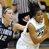 Ashley Wilson of Colorado  gets a steal from Lindsay Kimmel of Villanova. during the second half of the March 22, 2012 game in Boulder. <br />  Cliff Grassmick / March 22, 2012