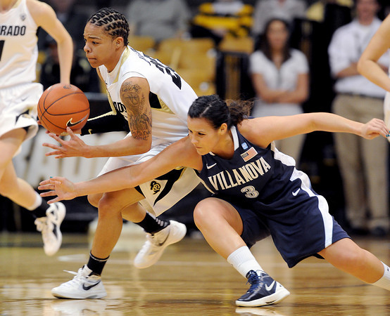 "Chucky Jeffery, left, of Colorado, gets a steal from Jesse Carey of Villanova during the first half of the March 22, 2012 game in Boulder. <br /> For more photos of the game, go to  <a href=""http://www.dailycamera.com"">http://www.dailycamera.com</a>.<br />  Cliff Grassmick / March 22, 2012"