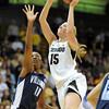 "Julie Seabrook of CU shoots over Taylor Holeman of Villanova<br /> during the first half of the March 22, 2012 game in Boulder. <br /> For more photos of the game, go to  <a href=""http://www.dailycamera.com"">http://www.dailycamera.com</a>.<br />  Cliff Grassmick / March 22, 2012"