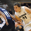 "Jasmine Sborov of CU dribbles past Taylor Holeman of Villanova<br /> during the first half of the March 22, 2012 game in Boulder. <br /> For more photos of the game, go to  <a href=""http://www.dailycamera.com"">http://www.dailycamera.com</a>.<br />  Cliff Grassmick / March 22, 2012"