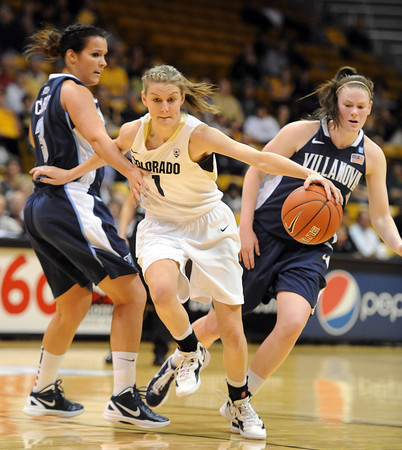 "Lexy Kresl of CU gets past Jesse Carey of Villanova<br /> during the first half of the March 22, 2012 game in Boulder. <br /> For more photos of the game, go to  <a href=""http://www.dailycamera.com"">http://www.dailycamera.com</a>.<br />  Cliff Grassmick / March 22, 2012"