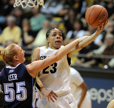 Chucky Jeffery of Colorado drives to the basket and is hit by Emily Leer of Villanova during the second half of the March 22, 2012 game in Boulder. <br />  Cliff Grassmick / March 22, 2012